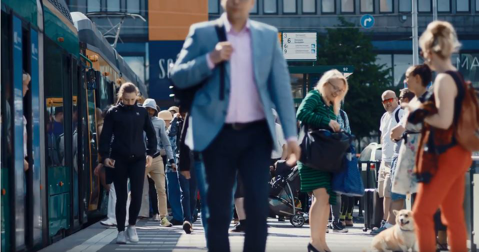 People walking on a busy train station in Finland